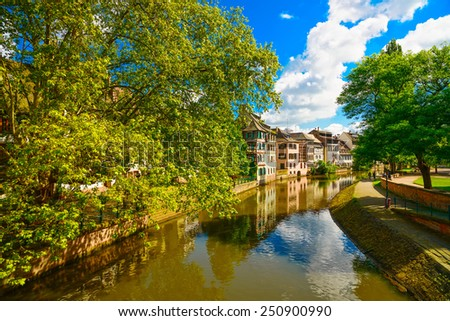Strasbourg, water canal in Petite France area. Half timbered houses and trees in Grand Ile. Alsace, France. Unesco Site. - stock photo