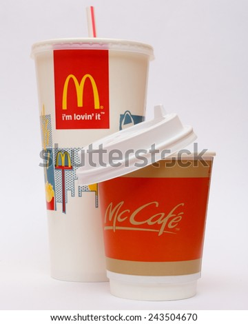 STRASNICE, CZECH REPUBLIC - JANUARY 11, 2015: McDonalds plastic cups for soda and coffee on grey background. McDonald's Corporation is the world's largest chain of hamburger fast food restaurants. - stock photo