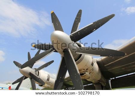 Strategic bomber propeller engine  against  cloudy sky background - stock photo