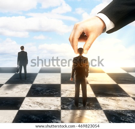 Strategic planning and control concept with hand moving businesspeople on chessboard. Sky background