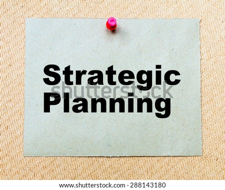 Strategic Planning written on paper note pinned with red thumbtack on wooden board. Business conceptual Image - stock photo
