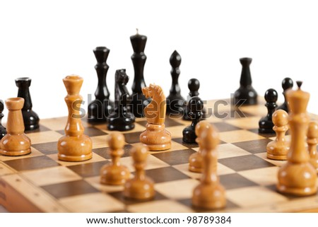 Strategy and competition chess game figures on wood board - stock photo