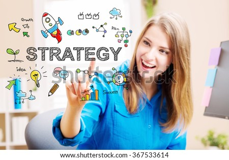 Strategy concept with young woman in her home office - stock photo