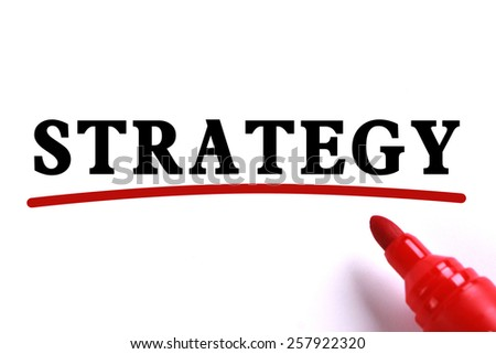 Strategy text is on white paper with red underline which is written by the red marker. - stock photo