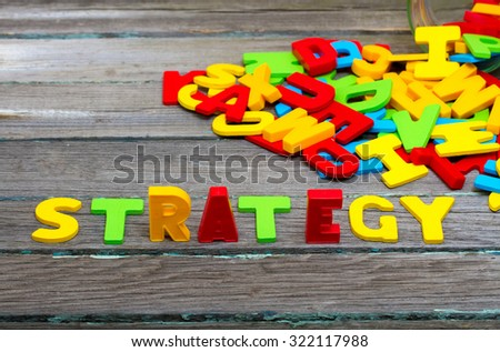 Strategy text on wood background - stock photo