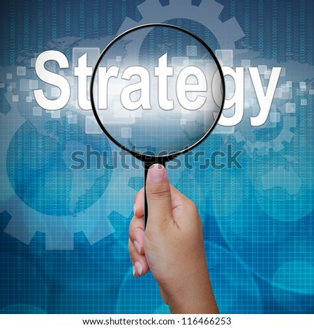 Strategy, word in Magnifying glass ,business background