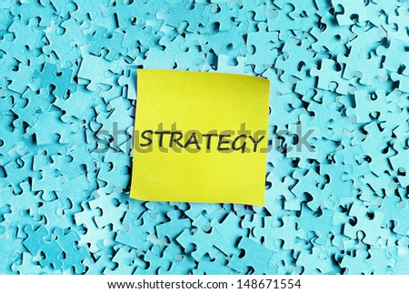 Strategy word on puzzle background  - stock photo