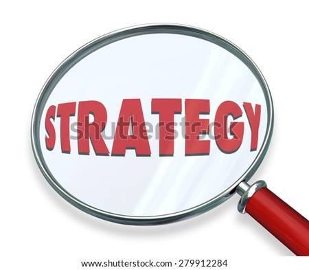 Strategy word under magnifying glass to illustrate evaluating, assessing or examining the tactics, procedure and steps toward achieving mission, plan, objective and success - stock photo