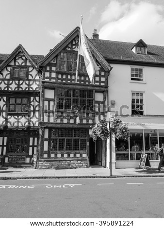 STRATFORD UPON AVON, UK - SEPTEMBER 26, 2015: Harvard House is the most elaborately decorated Elizabethan house build during Shakespeare lifetime in black and white
