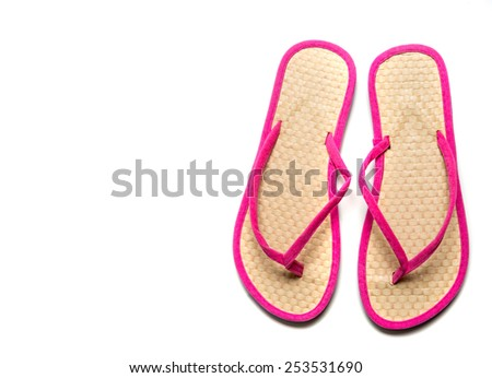 Straw and pink flip-flop sandals on a white background with copy space - stock photo