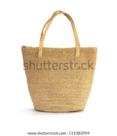 Straw bag on a white background - stock photo
