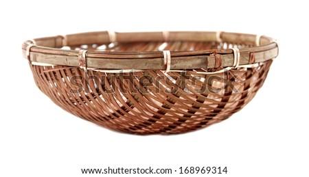 Straw basket over white background - stock photo