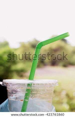 straw green tube refreshed with condensation of water ice, fresh lifestyle - stock photo