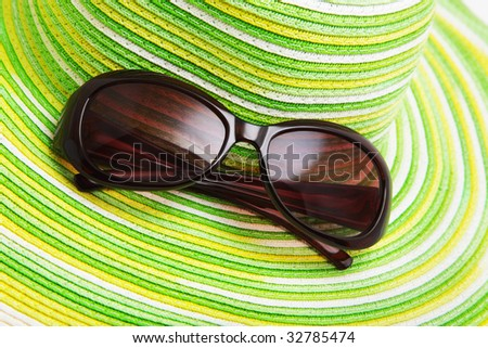 Straw hat and sunglasses - stock photo