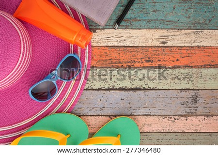 Straw hat and sunglasses on vintage wood.Summer holiday background concept.Copy space. - stock photo