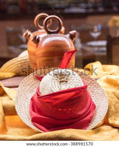 Straw hat and water clay pot as decoration.Both items are typical of the Cuban peasants - stock photo
