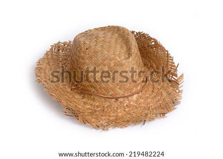 Straw hat for sun protection on the beach in summer. - stock photo