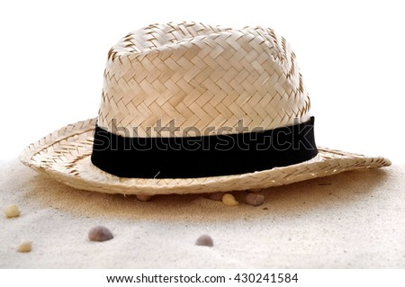 straw hat in the sand on white background