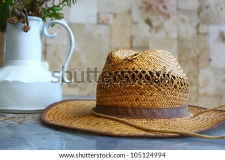 straw hat on garden table