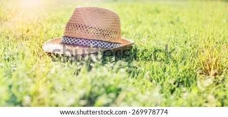 straw hat on grass during summer season  . - stock photo