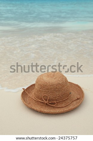 Straw Hat on tropical island beach