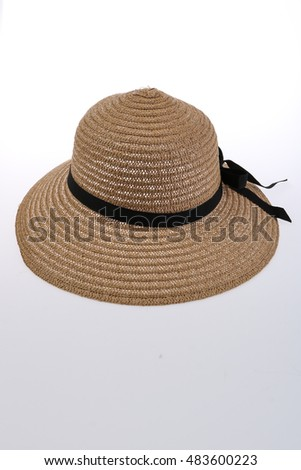 Straw hat with black ribbon isolated on white background.