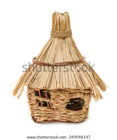 Straw house isolated on white background. Building concept.