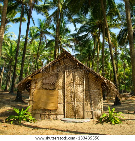 Straw hut on Paradise beach in Goa, India - stock photo