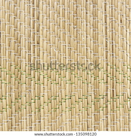 Straw mat texture of a rush matting for the sand. - stock photo