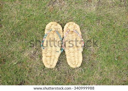 Straw sandals - stock photo