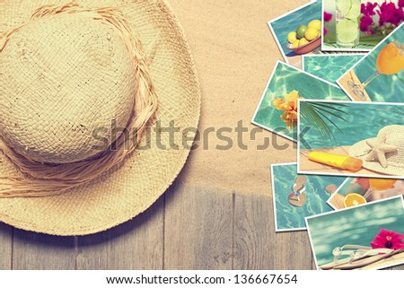 Straw sunhat with postcards of summer vacation - stock photo