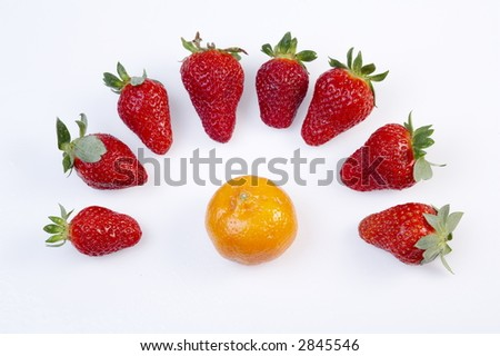 strawberries and an orange on white background - stock photo