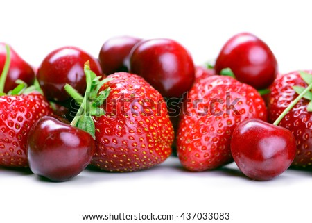 Strawberries and cherry isolated on white background