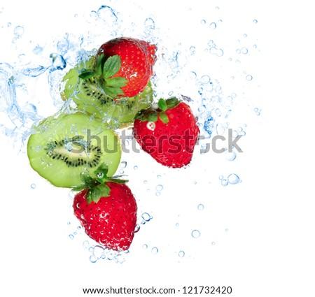 strawberries and kiwi water splash isolated on white - stock photo