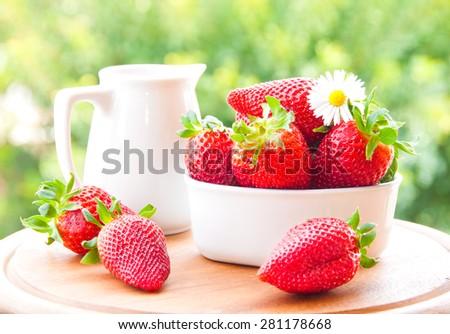 Strawberries and milk  - stock photo