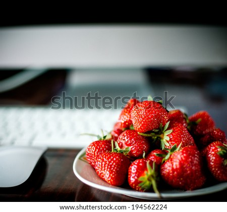 strawberries as an assistant in creative ways - stock photo