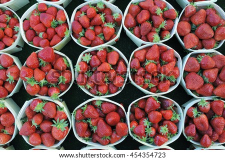 Strawberries at a greengrocer at a market in France