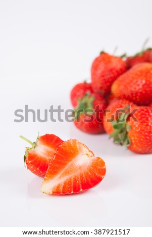 Strawberries berry close up on white background