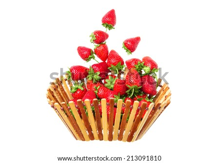 strawberries flying in a wooden bowl, isolated on white background - stock photo