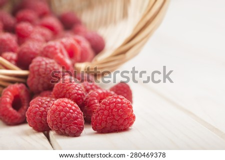 strawberries in a basket on the table in the garden - stock photo