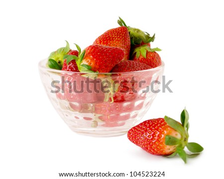 Strawberries in a glass bowl on a white background - stock photo