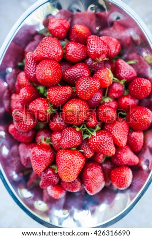 strawberries in a metal bowl - stock photo
