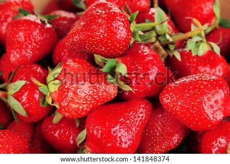 Strawberries in bowl close-up background - stock photo