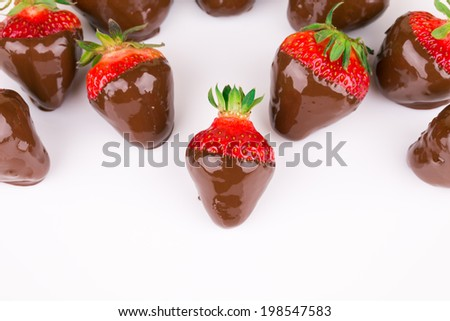 Strawberries in chocolate on the white background