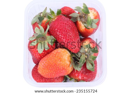 Strawberries in plastic box isolated on white background  - stock photo