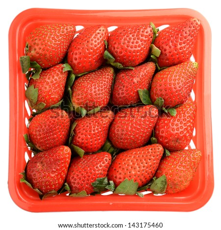 Strawberries in plastic container isolated on white background. File contains a path to isolation. - stock photo