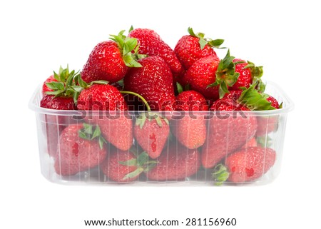 Strawberries in plastic packaging, isolated on white background - stock photo