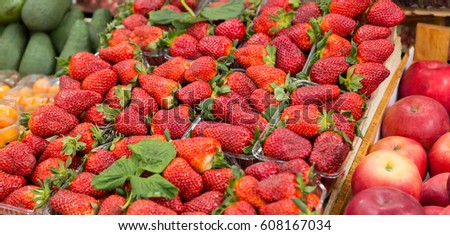 Strawberries in the tray on the market.