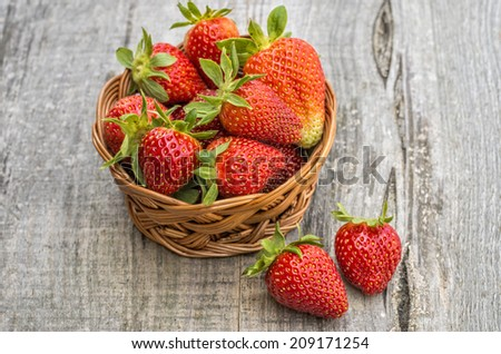 Strawberries in wooden background