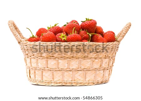 Strawberries in wooden basket isolated on white